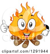 Clipart Of A Cartoon Happy Campfire Character Giving A Thumb Up Royalty Free Vector Illustration by BNP Design Studio