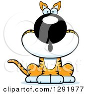 Clipart Of A Cartoon Surprised Gasping Sitting Tasmanian Tiger Royalty Free Vector Illustration