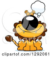 Clipart Of A Cartoon Dreaming Or Thinking Male Lion Sitting Royalty Free Vector Illustration