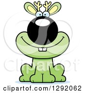 Clipart Of A Cartoon Happy Green Jackalope Sitting Royalty Free Vector Illustration by Cory Thoman