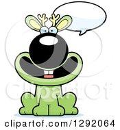 Clipart Of A Cartoon Happy Talking Green Jackalope Sitting Royalty Free Vector Illustration