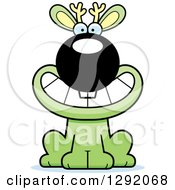 Clipart Of A Cartoon Happy Grinning Green Jackalope Sitting Royalty Free Vector Illustration