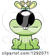 Clipart Of A Cartoon Bored Green Jackalope Sitting Royalty Free Vector Illustration