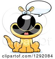 Clipart Of A Cartoon Happy Sitting And Talking Yellow Kangaroo Royalty Free Vector Illustration by Cory Thoman