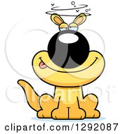 Clipart Of A Cartoon Drunk Or Dizzy Sitting Yellow Kangaroo Royalty Free Vector Illustration by Cory Thoman