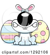 Clipart Of A Cartoon Mad Snarling White Easter Bunny With Eggs Royalty Free Vector Illustration by Cory Thoman