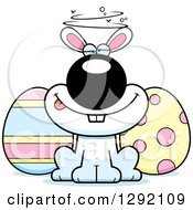 Clipart Of A Cartoon Drunk Or Dizzy White Easter Bunny With Eggs Royalty Free Vector Illustration by Cory Thoman