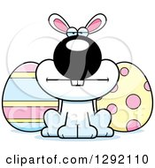 Clipart Of A Cartoon Mad White Easter Bunny With Eggs Royalty Free Vector Illustration by Cory Thoman