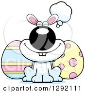 Clipart Of A Cartoon Dreaming Or Thinking Happy White Easter Bunny With Eggs Royalty Free Vector Illustration by Cory Thoman