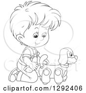 Clipart Of A Black And White Boy Playing With A Toy Dog Royalty Free Vector Illustration