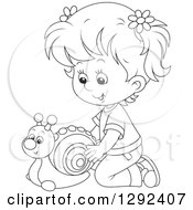 Clipart Of A Black And White Girl Playing With A Toy Snail Royalty Free Vector Illustration