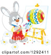 Clipart Of A Happy Gray Easter Rabbit Painting An Egg On An Easel Royalty Free Vector Illustration