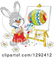 Clipart Of A Happy Gray Easter Bunny Painting An Egg On An Easel Royalty Free Vector Illustration