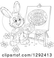 Clipart Of A Happy Black And White Easter Bunny Painting An Egg On An Easel Royalty Free Vector Illustration