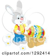 Clipart Of A Happy Gray Easter Rabbit Pushing A Giant Egg In A Wheelbarrow And Waving Royalty Free Vector Illustration
