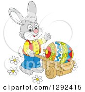 Happy Gray Easter Bunny Pushing A Giant Egg In A Wheelbarrow And Waving