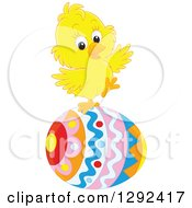 Clipart Of A Cute Yellow Easter Chick Balancing On A Decorated Egg Royalty Free Vector Illustration