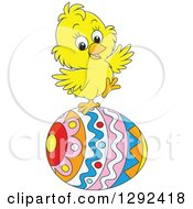 Clipart Of A Happy Yellow Easter Chick Balancing On A Decorated Egg Royalty Free Vector Illustration