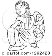 Clipart Of A Black And White Angel Kneeling And Praying Royalty Free Vector Illustration