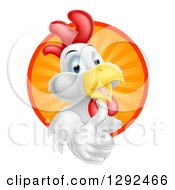 Clipart Of A Happy White Rooster Holding A Thumb Up And Emerging From A Sunshine Circle Royalty Free Vector Illustration by AtStockIllustration