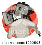 Clipart Of A Rear View Of A Retro Cameraman Filming In A Red Circle Royalty Free Vector Illustration