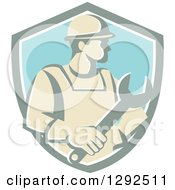 Clipart Of A Retro Male Construction Worker Holding A Giant Wrench In A Pastel Shield Royalty Free Vector Illustration