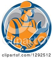 Clipart Of A Retro Orange Male Construction Worker Holding A Giant Wrench In A Blue White And Gray Circle Royalty Free Vector Illustration