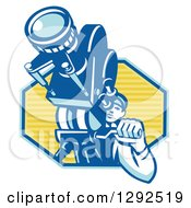 Clipart Of A Retro Male Cameraman Filming In A Blue And Yellow Hexagon Royalty Free Vector Illustration
