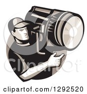 Clipart Of A Retro Male Film Crew Worker Holding A Spotlight Fresnel In A Circle Royalty Free Vector Illustration