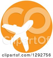 Clipart of a White Silhouetted Commercial Airplane Merging in an Orange Circle - Royalty Free Vector Illustration by ColorMagic #COLLC1292756-0187