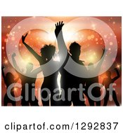 Clipart Of A Group Of Young Silhouetted Dancers Against Orange Flares And Lights Royalty Free Vector Illustration