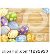 Clipart Of 3d Colorful Patterned Easter Eggs Over Wood With Text Space Royalty Free Vector Illustration by AtStockIllustration