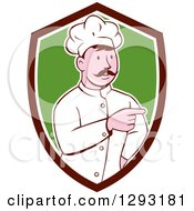 Clipart Of A Retro Cartoon White Male Head Chef With A Mustache Pointing In A Brown White And Green Shield Royalty Free Vector Illustration