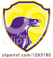 Clipart Of A Retro Woodcut Raven Crow In A Yellow Purple And White Shield Royalty Free Vector Illustration by patrimonio