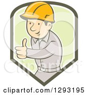 Clipart Of A Retro Cartoon White Male Construction Worker Foreman Giving A Thumb Up In A Green And White Shield Royalty Free Vector Illustration