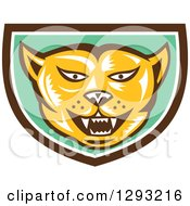 Clipart Of A Retro Woodcut Cougar Puma Mountain Lion Head In A Brown White And Green Shield Royalty Free Vector Illustration by patrimonio