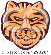 Clipart Of A Retro Tiger Head In Brown White And Orange Royalty Free Vector Illustration by patrimonio