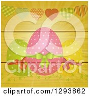 Clipart Of A Background Of Polka Dot Easter Eggs Vines And A Heart Bunting With Rays On Wood Royalty Free Vector Illustration