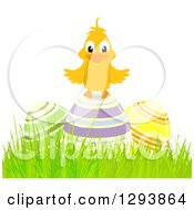 Clipart Of A Happy Chick On 3d Colorful Striped Easter Eggs In Grass Royalty Free Vector Illustration by elaineitalia