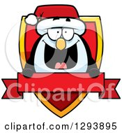 Clipart Of A Badge Or Label Of A Happy Christmas Penguin Over A Shield And Blank Banner Royalty Free Vector Illustration