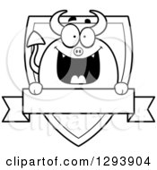 Badge Or Label Of A Black And White Happy Devil Over A Shield And Blank Banner