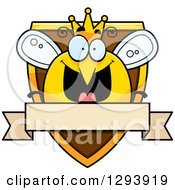 Clipart Of A Badge Or Label Of A Happy Queen Or King Bee Over A Shield And Blank Banner Royalty Free Vector Illustration