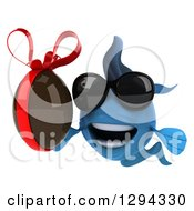 Clipart Of A 3d Blue Fish Wearing Sunglasses And Holding A Chocolate Easter Egg Royalty Free Illustration