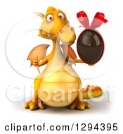Clipart Of A 3d Yellow Dragon Giving A Thumb Up And Holding A Chocolate Easter Egg Royalty Free Illustration by Julos