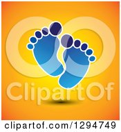 Clipart Of A Pair Of Blue Baby Footprints Floating On Orange Royalty Free Vector Illustration