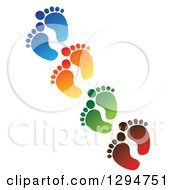 Diagonal Line Of Blue Orange Green And Red Baby Foot Prints