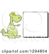 Clipart Of A Cartoon Green Spotted Dinosaur Pointing To A Blank Sign Royalty Free Vector Illustration