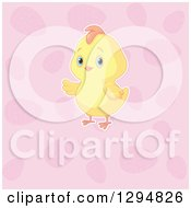 Clipart Of A Cute Yellow Easter Chick Presenting Over A Pattern Of Pink Eggs Royalty Free Vector Illustration