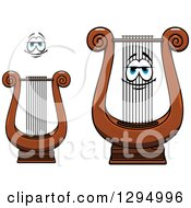 Clipart Of A Cartoon Face And Lyre Instruments Royalty Free Vector Illustration