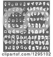 Clipart Of Grayscale Torn Piece Of Paper With Alphabet Letters Royalty Free Vector Illustration